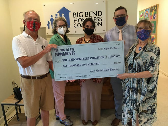 Composer James A. (Andy) Moorer and poet Donna Decker, along with producer Ralph Guggenheim (not shown), present the Big Bend Homeless Coalition's Executive Director Sylvia Smith, Director of Development Henry Gibson, and Volunteer Coordinator Annie Rada with a $1,500 contribution on Sept. 1, 2021.