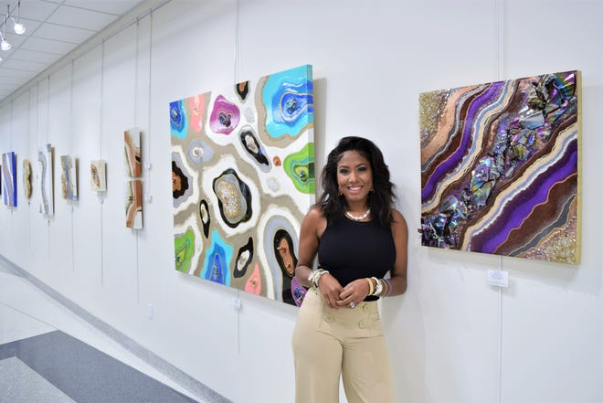 """Quia Z. Atkinson, artist and owner of the QZ Design Gallery, is featured at the """"In Flux"""" exhibit at the Artport Gallery."""