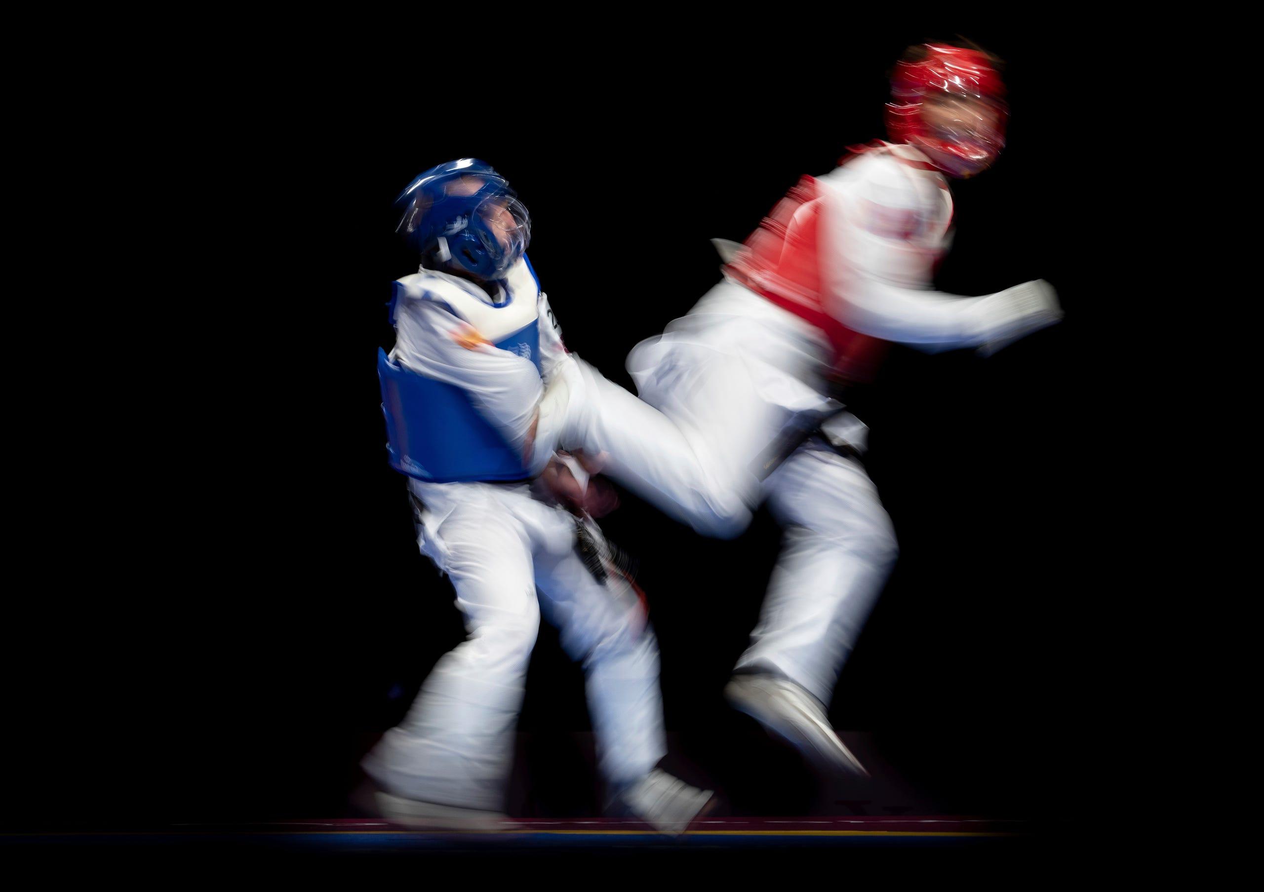 Sept. 2: Alejandro Vidal Alvarez of Spain (blue) fights against Bolor Erdene Ganbat of Mongolia (red) in the men's K44 61kg taekwondo repecharge at the Tokyo 2020 Paralympic Games in Chiba.
