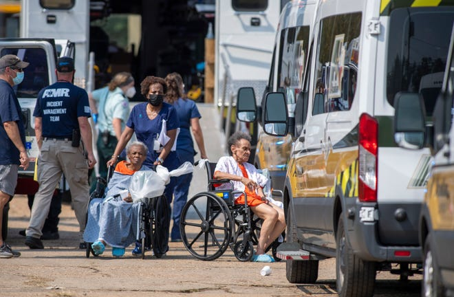 Paramedics evacuate nursing home residents Sept. 2 from a mass shelter in Independence, where they had been taken in advance of Hurricane Ida.