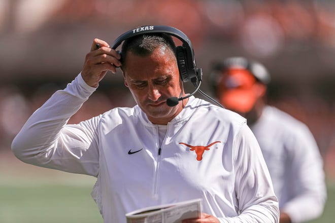 New Longhorns head coach Steve Sarkisian reviews his playbook during Texas' win over Louisiana on Saturday. It was just one game in a long season, but Texas looked solid against the then-No. 23 team in the country.
