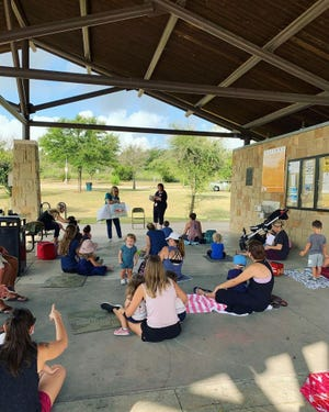 Meeting on Friday mornings in Bee Cave Central Park, the Bee Cave Public Library's Outdoor Storytime features stories, songs and movement for toddlers and preschoolers.