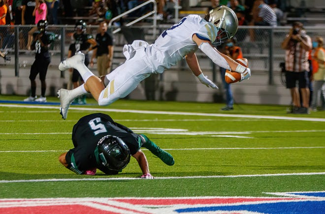 Regents Knights wide receiver Tyler Kuo hurdles over Connally Cougars defensive back Owen Garcia for the touchdown during the third quarter on Sept. 3 at The Pfield. Regents defense had six takeaways and quarterback Drew Dickey accounted for six touchdowns to help the Knights shut out Connally 55-0.
