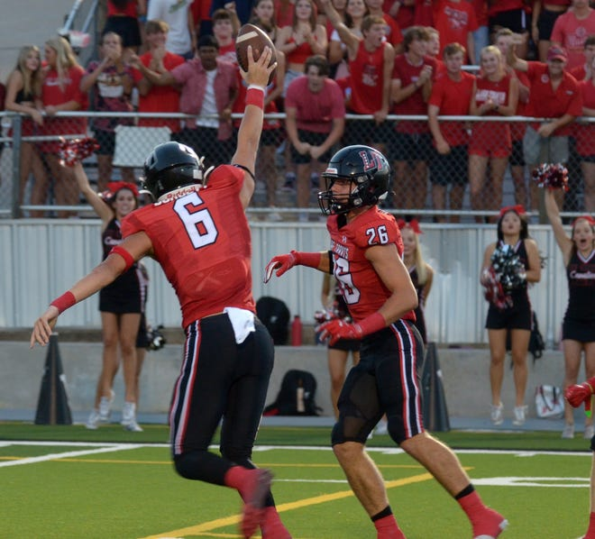 Lake Travis defensive end Trey Dorsett, left, celebrates with teammate Jayden Walker after recovering a fumble early in Friday's game at Cavalier Stadium. Lake Travis topped Judson 52-20 to improve to 2-0.
