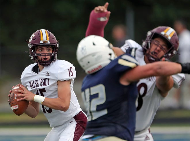 Walsh Jesuit quarterback Matt Natale searches for an open man during the first half of a high school football game, Friday, Sept. 3, 2021, in Akron, Ohio.