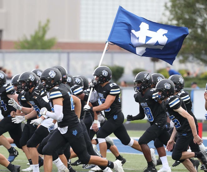 The CVCA football team takes to the field before their game against Woodridge at CVCA Friday, Sept. 3, 2021 in Cuyahoga Falls, Ohio.