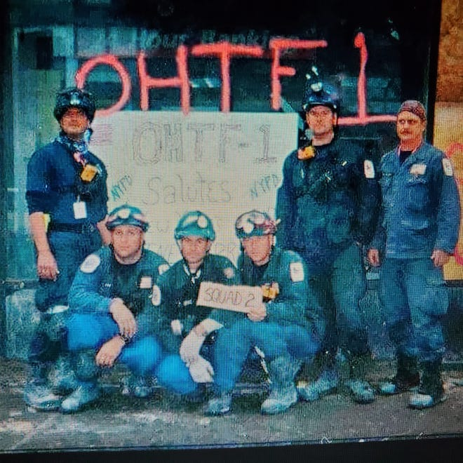 Tim Lombardi, far left, with members of Ohio Task Force One, Rescue Squad 2, at ground zero in New York City in 2001. Lombardi at the time was a lieutenant on the Cuyahoga Falls Fire Department at the time.