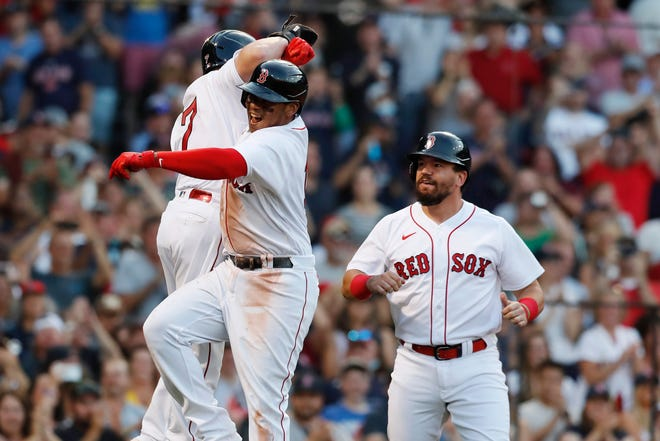 Boston Red Sox  third baseman Rafael Devers, center, celebrates his three-run home run in the seventh inning of a 4-3 win over Cleveland on Saturday. [Michael Dwyer/Associated Press]
