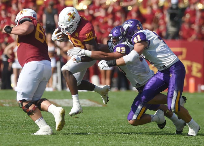 Iowa State's running back Breece Hall bracks a tackle from UNI's linebacker Spencer Cuvelier and defensive lineman Caden Houghtelling during the second quarter at Jack Trice Stadium Saturday, Sept. 4, 2021, in Ames, Iowa.