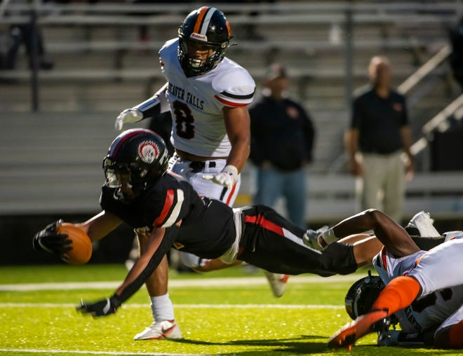 Aliquippa's Cameron Lindsay dives for the end zone as the Quips beat Beaver Falls 39-25 at Reeves Stadium on Sept. 3, 2021. [Lucy Schaly/For BCT]
