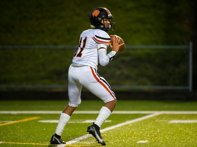 Beaver Falls QB Jaren Brickner looks to pass against Aliquippa during their game at Reeves Stadium on Sept. 3, 2021. [Lucy Schaly/For BCT]