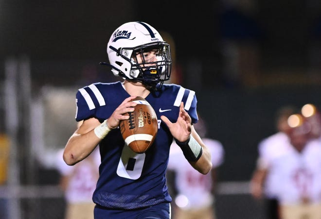 Rochester's J.D. Azulay looks to throw during Friday night's game against New Brighton at Rochester Area High School.