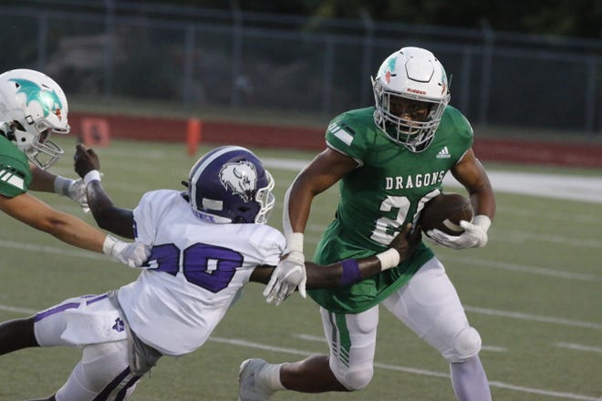Bangs Dragons running back Guy Powell begins to turn upfield in first-half action against the Florence Buffaloes Friday night at Dragon Memorial Stadium. Florence defeated Bangs 45-14.