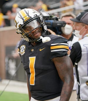 Missouri Tigers running back Tyler Badie (1) celebrates after scoring against the Central Michigan Chippewas during the first half at Faurot Field Saturday.