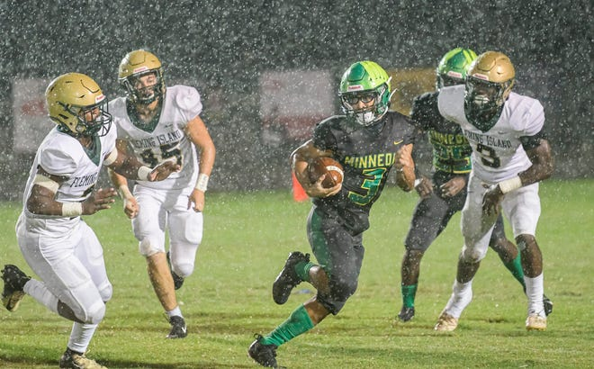 Lake Minneola's Braylon Knauth (3) makes a carry during a game between Lake Minneola High School and Orange Park Fleming Island High School in Minneola on Friday, Sept. 3, 2021. [PAUL RYAN / CORRESPONDENT]