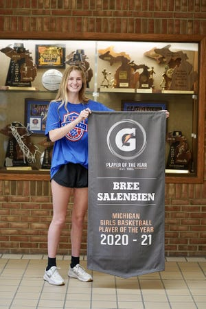 Bree Salenbien holds up her Gatorade 2020-21 Michigan Girls Basketball Player of the Year banner. [Submitted photo]