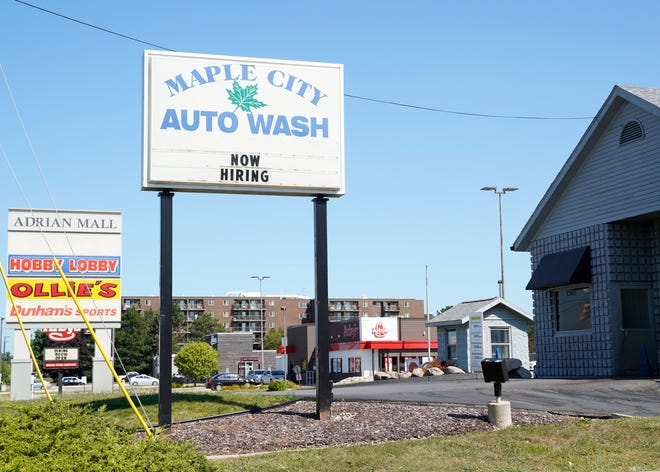 """Maple City Auto Wash in Adrian, 1363 S. Main St., is one of many businesses in Lenawee County that has been advertising its need for workers and that it is """"now hiring."""""""