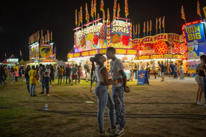 Payton Pierce and Torence Boatwright share a kiss at the Maury County Fair & Exposition in Columbia, Tenn., on Friday, Sept. 3, 2021.