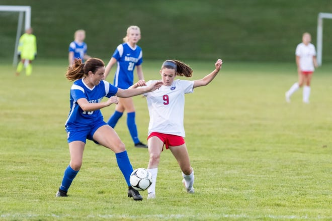 Hornell's Allyson Buckley fights for possession of the ball during a 2-1 win over Haverling on Friday evening.
