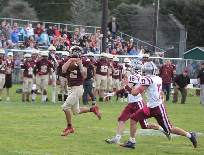Dan-Way-Co's Evan Pruonto hauls in a reception on Friday night as DWC picked up their first win in program history.