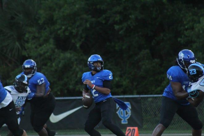 Freshman quarterback Colin Hurley drops back to pass against Ribault.