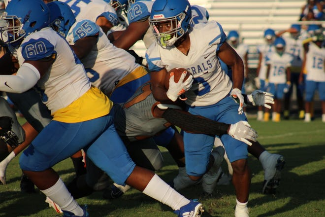 Riverside running back Alvin Gibson (3) breaks a tackle during a high school football game against Atlantic Coast on September 3, 2021. [Clayton Freeman/Florida Times-Union]