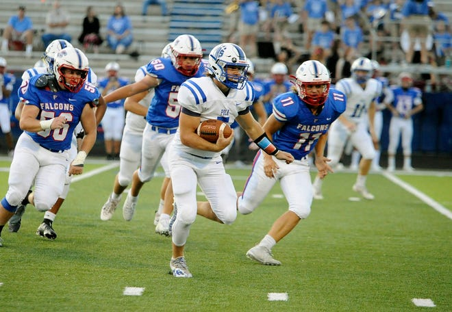 Polk County's Angus Weaver breaks away for a big gain during Friday's game at West Henderson.