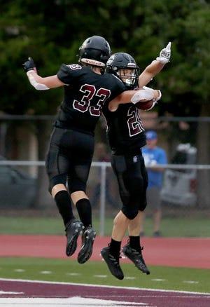 Buhler's Dalin Coffey (33) celebrates Sam Elliott's (20) touchdown during their win against Goddard 42-14  Friday night in Buhler.