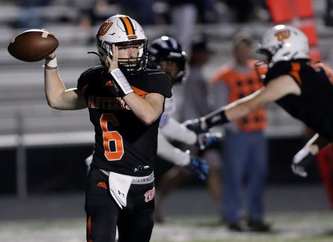 Washington quarterback Noah Berlett looks to throw during their nonconference game last week against Kankakee at Babcook Field in Washington.