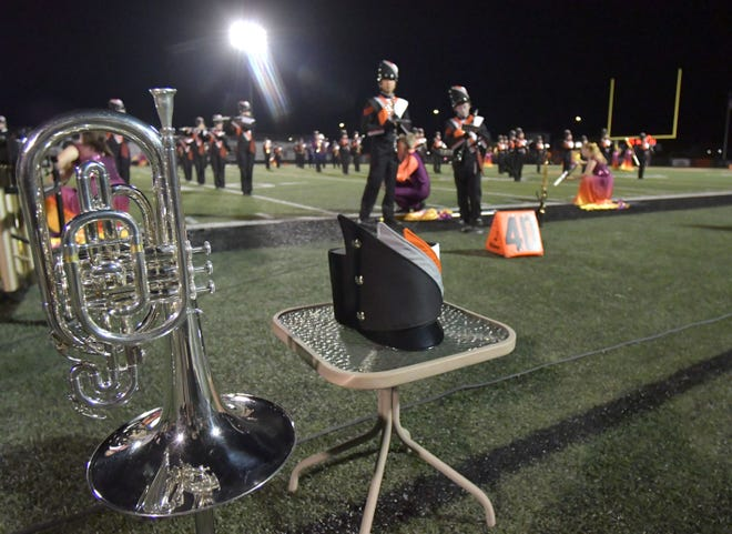 An instrument and a uniform hat are placed on the sidelines in remembrance of a Washington Community High School band member who died in a car accident during the summer.