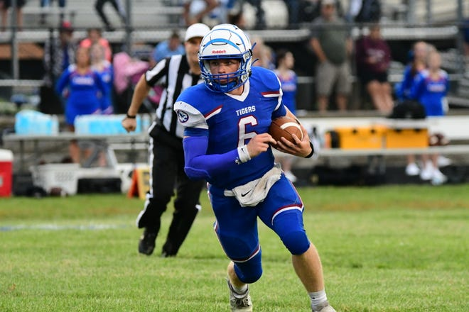 Scotland County quarterback Hayden Long runs for a first down during the first half of Friday's game against Fayette.