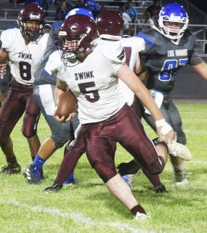 Swink High School's Clay Roweth runs for yardage in Friday's game at Las Animas. Roweth ran for 71 yards on 10 carries.