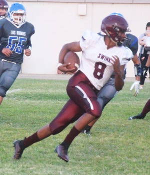 Swink High School's Garlon Guerin ran for 186 yards on 17 carries in the Lions' 52-16 win at Las Animas on Friday.