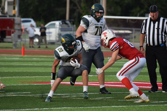 Basehor-Linwood senior running back Zack Sisemore starts to spin around a Tonganoxie defender in the Bobcats' 27-6 win Friday. Sisemore scored four total touchdowns in the win.