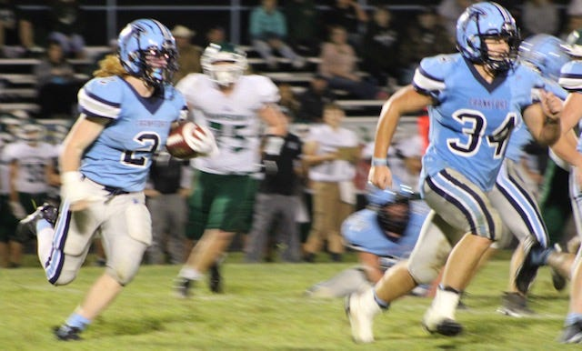 Frankfort's Peyton Clark follows the block of Parker VanMeter in the Falcons' 21-8 win over Hampshire Friday, bringing their record to 2-0.