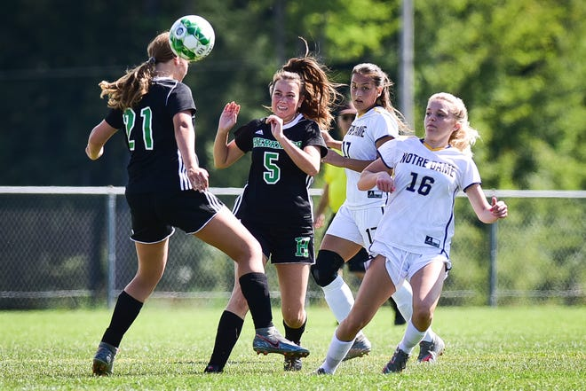 Herkimer players Arrissa Bunker (21) and Kassidy Brown (5) attempt to settle the ball during against Notre Dame players Kathryn Williams (17) and Ariana Piazza (16) on Saturday, September 4, 2021. Notre Dame won 1-0.