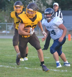 Pellston junior running back Garrett Cameron looks to break loose against Hale during the first half of a varsity football contest at Sam McClutchey Field on Friday night. Cameron had three touchdown runs in a 36-12 Pellston victory.