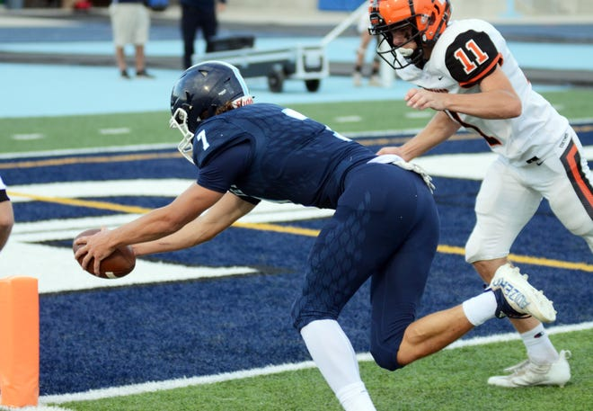Petoskey's Gavin Wargel reaches for the pylon for the game's first score against Escanaba Friday night.