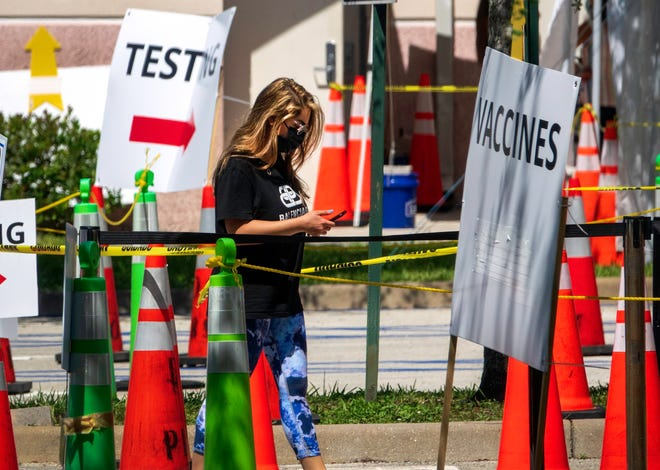 A woman heads to the vaccine line at the Mid County Senior Center in Palm Springs. The site run by the Florida Department of Health in Palm Beach County offers both vaccinations and testing for COVID-19.