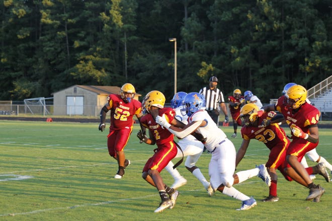Some contact between the two football teams as a play unfolds.