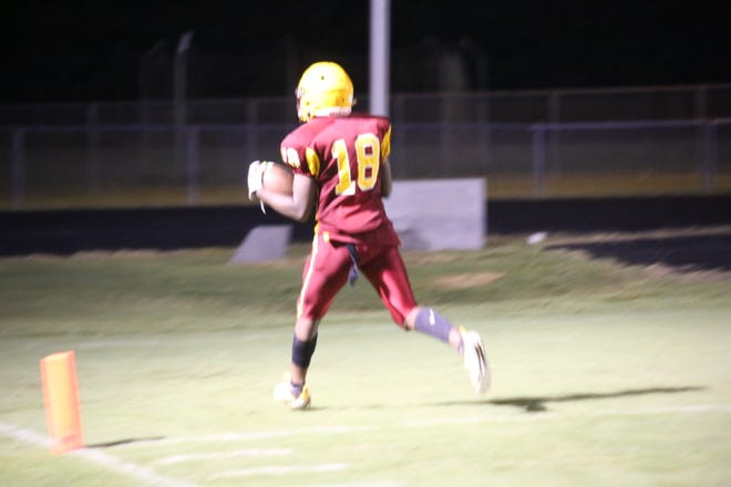 Rayjuan Traynham reaches the endzone after a run that broke a few tackles against Armstrong.