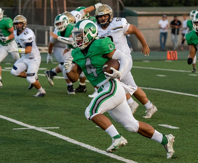 St. Mary's High's Pauli Mafi takes the opening kickoff 52 yards against Central Catholic High on Sept. 3.