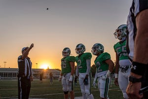 St. Mary's High and Central Catholic High gather for the coin toss before the Holy Bowl Friday September 3, 2021.
