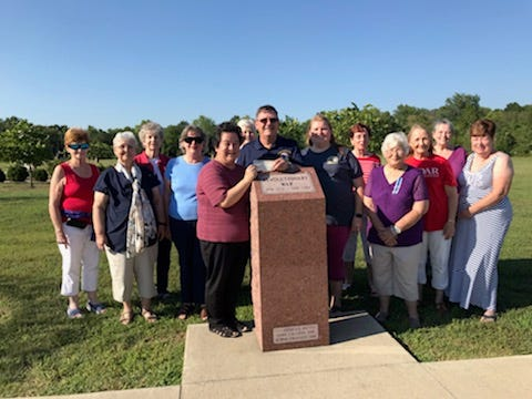 The Noah Coleman Chapter of the Daughters of the American Revolution is pictured in front of the Revolutionary Way monument at Veterans Memorial Park in Rolla.