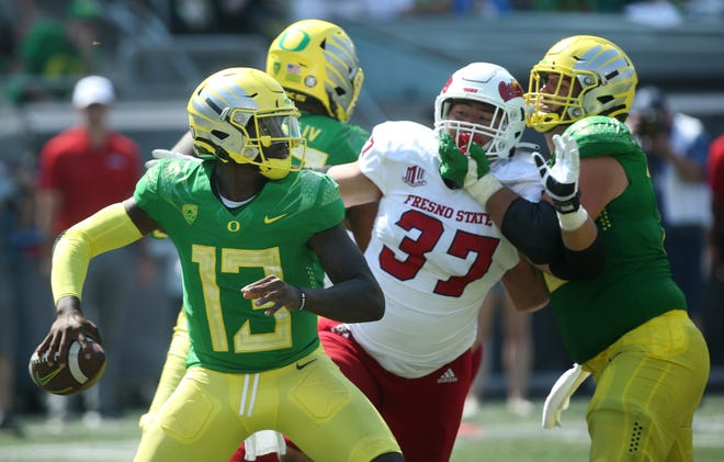Quarterback Anthony Brown Jr., left, throws downfield against Fresno State in the third quarter.