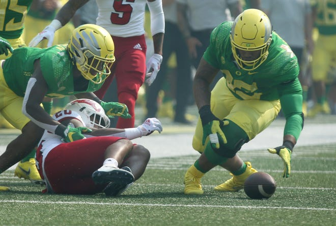 Oregon's Keyon Ware-Hudson, right, jumps on a fumble by Fresno State's Ronnie Rivers during the first quarter of their Sept. 4 game at Autzen Stadium.