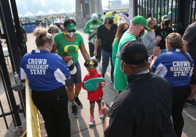 Oregon fans make their way through the east gate at Autzen Stadium for the season opener against Fresno State.
