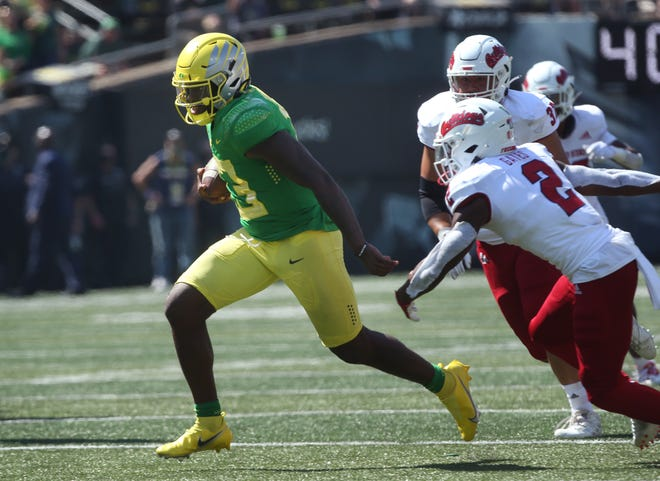 Oregon quarterback Anthony Brown breaks through the Fresno State defense for the game-winning 30-yard touchdown run in the fourth quarter of the Ducks' 31-24 victory at Autzen Stadium.
