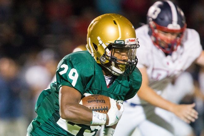 Boylan's Mekhi Glover, shown running against Belvidere North last week, has 152 yards and 3 TDs in two games, averaging 8.4 yards per carry.