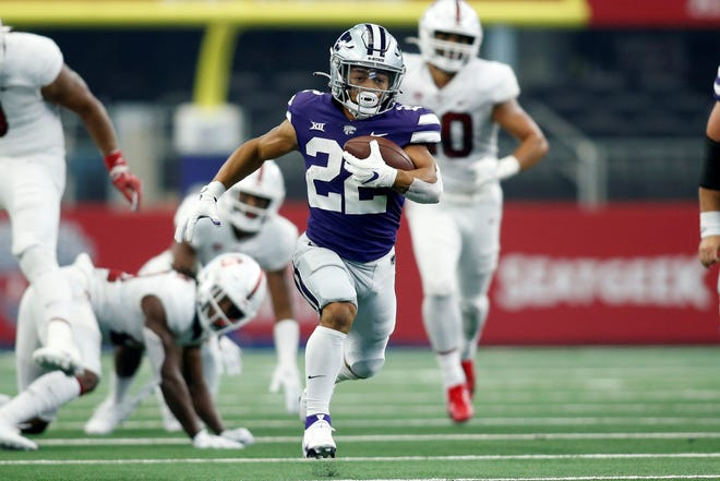 Kansas State running back Deuce Vaughn (22) runs for a touchdown in the second quarter against Stanford  at AT&T Stadium.